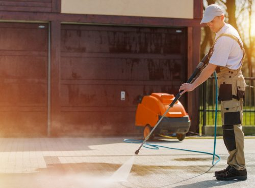 Cleaning Brick Road:cleaning, brick, pavement, water, house, clean, pressure, high pressure, spraying, spray, men, caucasian, work, job, spring, labor, man, male, machine, system, mechanical, household, horizontal
